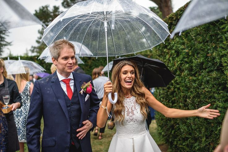 Bride and groom from a rainy day Chic and Glamorous Country House Wedding. Images by Guy Collier