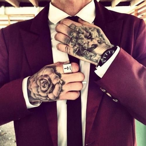 A suit and tattoos always goes together...perfectly. This Razor Doll likes, how about you?