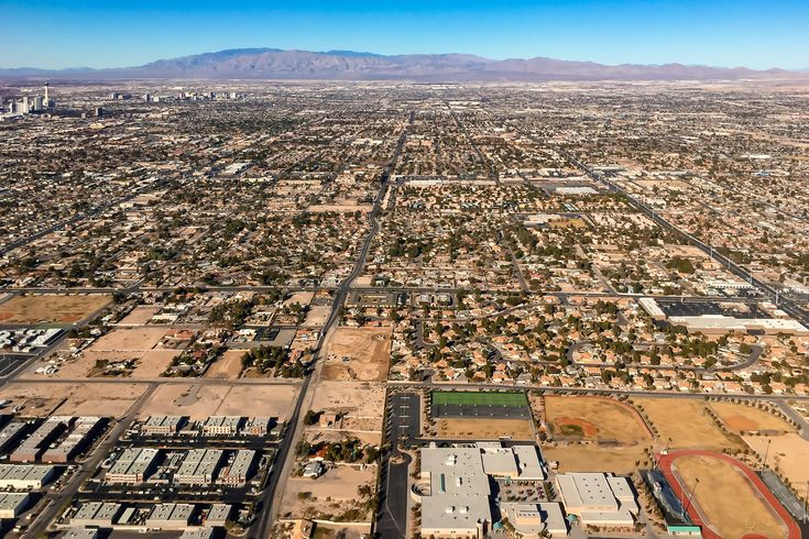 The city grid of Las Vegas rises from the Nevada desert.  See more #photos at 75central.com