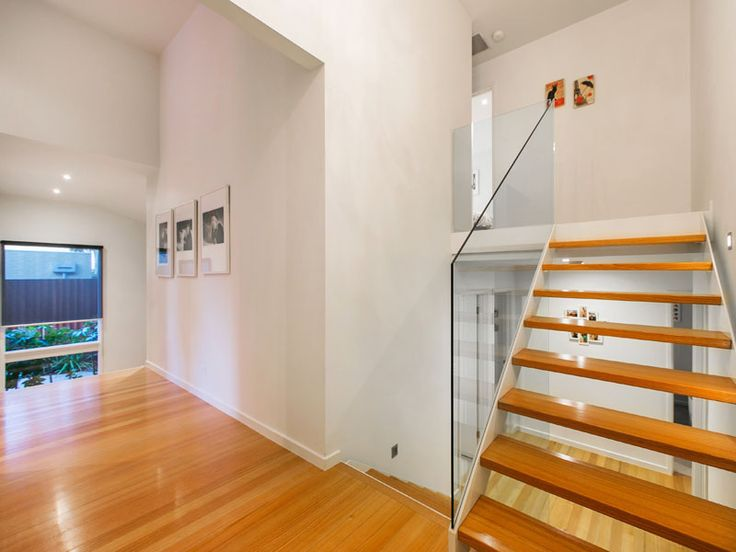 Strickland Drive |  Stairs | Glass Balustrade | Wooden Treads | Steel frame | White powder coat steel
