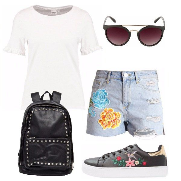 L' outfit è formato da una maglietta con scollo tondo, un paio di shorts in jeans con le patch ed orlo tagliato a vivo, un paio di occhiali da sole, delle sneakers ed uno zaino nero con le borchie.