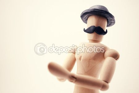 Classic wooden dummy with black mustache and black hat in retro style. #woodendummy #mannequin #mustache #hat