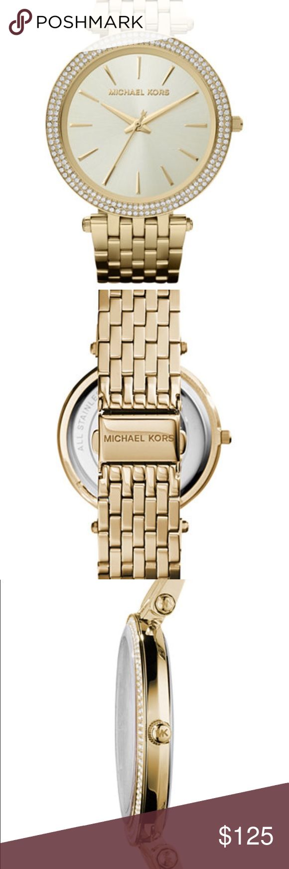MK Gold Watch Womens Used An elegant addition to your collection: a glistening Darci watch from Michael Kors •Gold Tone  stainless steel bracelet (6-9/10L) •39mm bezel crystallized with Swarovski elements •Light Champagne dial with gold-tone stick markers and three hands •Quartz Movement •Water Resistant 50 Meters •One Tiny minor scratch on face of watch KORS Michael Kors Accessories Watches