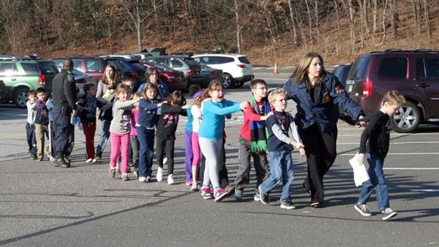 State police personnel led children from the school, following a shooting at Sandy Hook Elementary, Dec. 14, 2012. Horror.