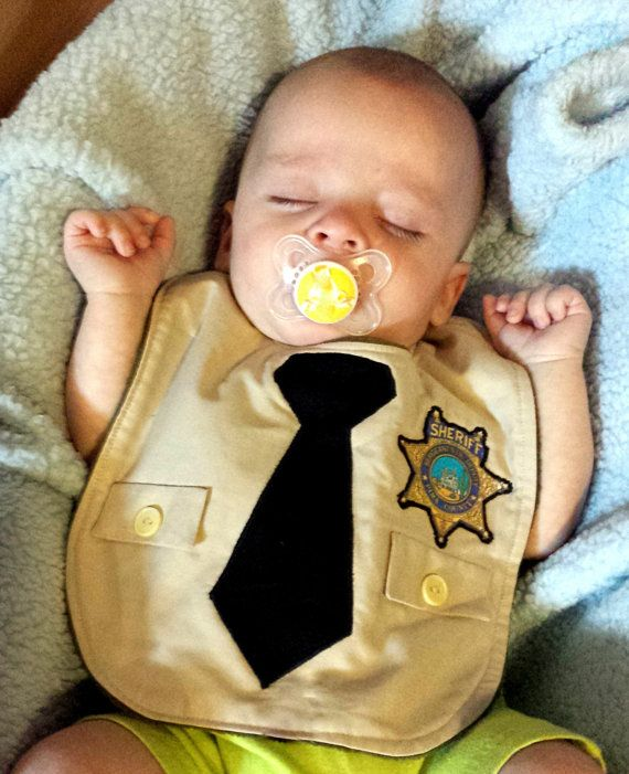 Every guy looks great in a uniform, right? Especially the little ones!  Customized Little Sheriff Deputy Police Officer by DebbieDoesThat, $16.00 Perfect gift for that little dude in your life whose loved one wears the uniform.