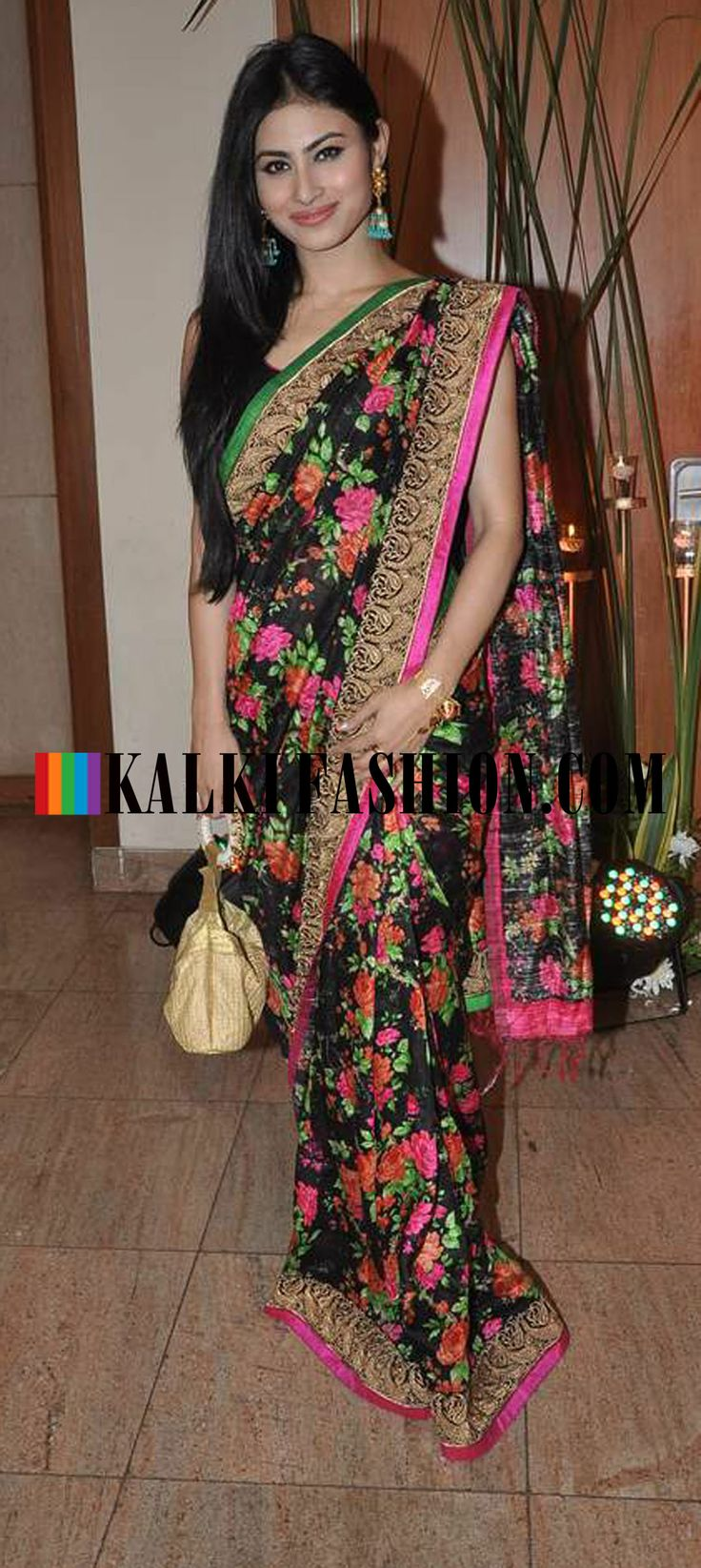 http://www.kalkifashion.com/ Mouni Roy in black floral printed saree at Ravi Dubey and Sargun Mehta's reception bash.