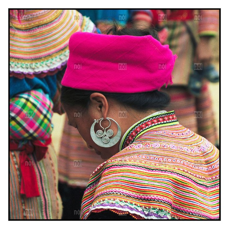 [photo by Francis Roux] Detail of earring worn by a Flower Hmong woman visiting the Can Cau market near Bac Ha, Vietnam, Southeast Asia