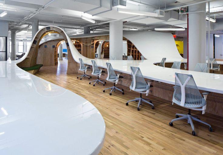 clive wilkinson designs undulating desk for the barbarian group - designboom | architecture & design magazine