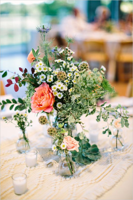 carefree wildflower centerpiece w. smaller flower vases around