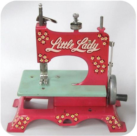 1950's child's pink little lady sewing machine. Oh, how toys have changed...