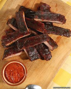 Oven-Roasted Ribs with Barbecue Sauce....put in platter with sauce pooling under and out like blood.
