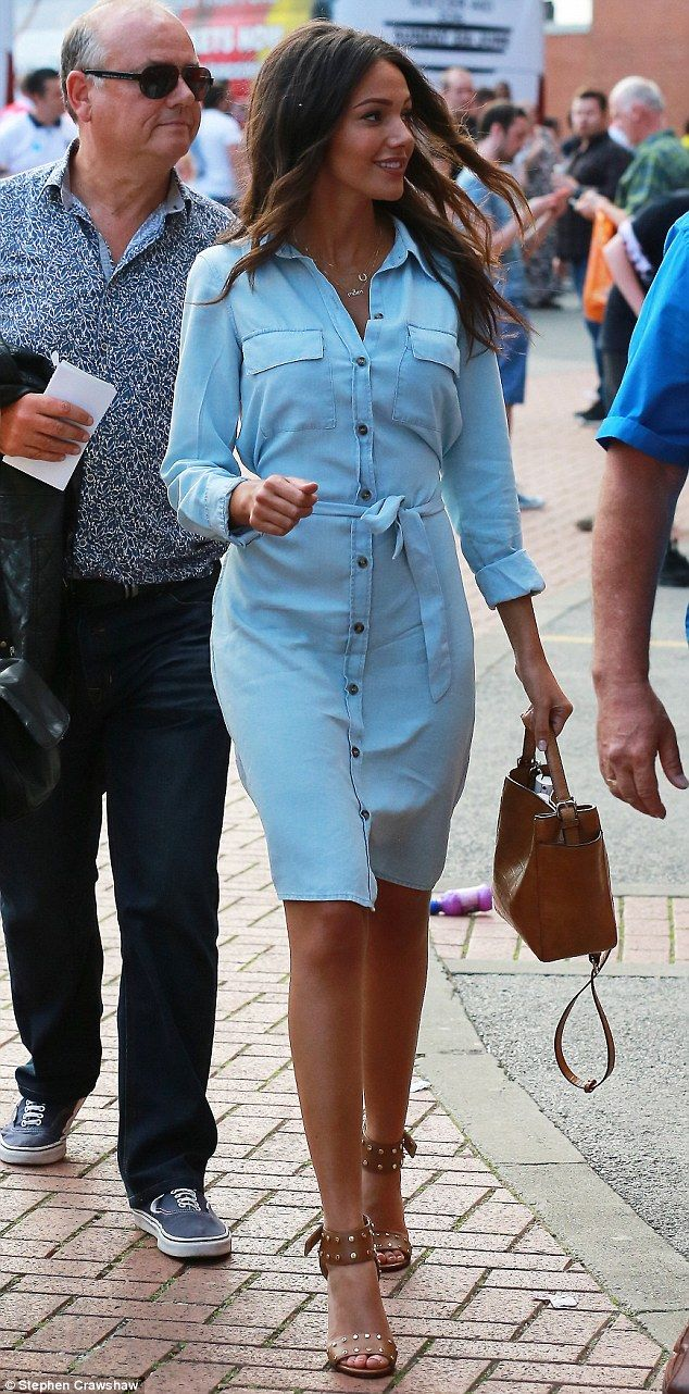 Babe in blue: Michelle Keegan arrives at Manchester's Old Trafford Stadium on Sunday to watch her husband Mark Wright take part in a charity football match