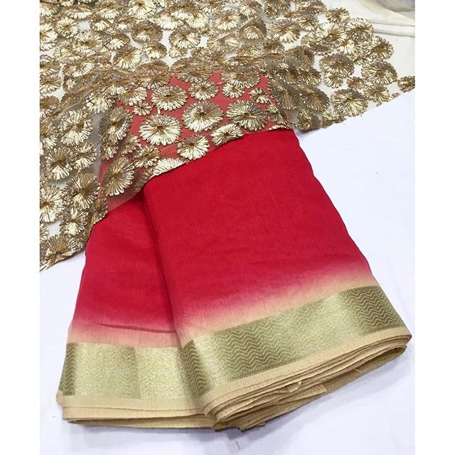 """Red shaded saree with gold heavy blouse To purchase this product mail us at…"