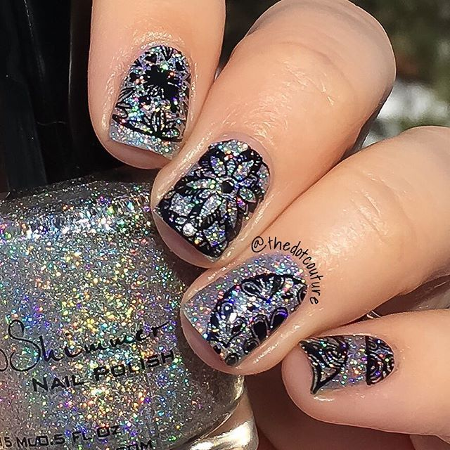 So much beautiful holo!!!! Stamped Nail art. @kbshimmer Alloy Matey! Stamped with @konad_art black stamping polish and @moyou_london Doodles plate 01.