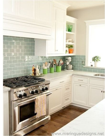 Beautiful kitchen! White to ceiling cabinets,  blue/gray subway tiles, dark floors.(love the tiles)