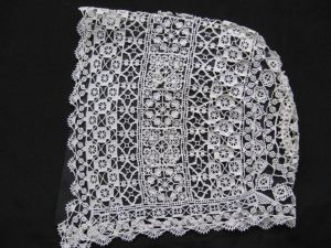 Small Cap worked in Puncetto which is a form of Needle Lace. A tutorial on this style of lace is available from this site.