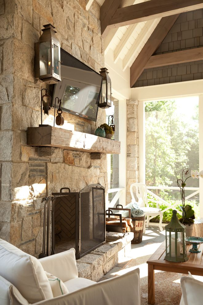Outdoor fireplace. Outdoor stone fireplace. A stone fireplace is the focal point of this screened-in porch. #fireplace #stonefireplace  T.S. Adams Studio. Interiors by Mary McWilliams from Mary Mac & Co.