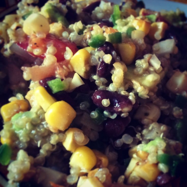 Quinoa salad with beans, avocado, tomatoes, roasted corn, onion ...
