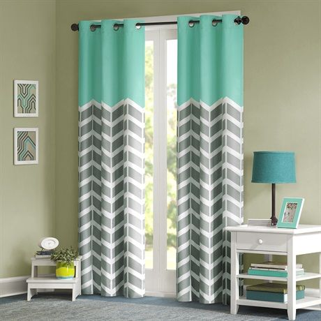 The Nadia window panel makes any bedroom fun and inviting! The panel features a fresh solid teal color top border with a grey and white chevron print that runs along the bottom broken up by white vertical stripes. The panel features a foam back panel that offers both superior room darkening and energy efficient.  A grommet top treatment that allows for easy opening and closing of the window panel.