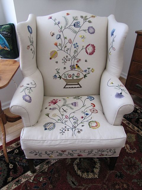 Crewel-embellished chair.  Anyone daring to sit on it must have a death wish!