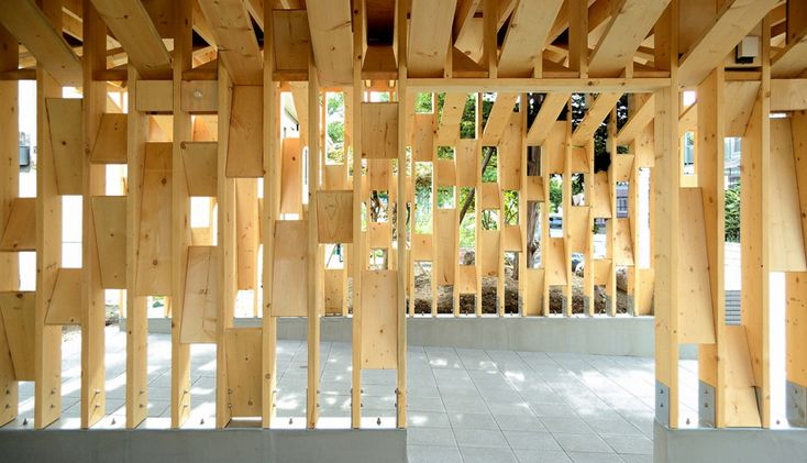 nestled in a garden in hokkaido, this timber pavilion uses traditional techniques of wood construction to produce its supporting frame and form.