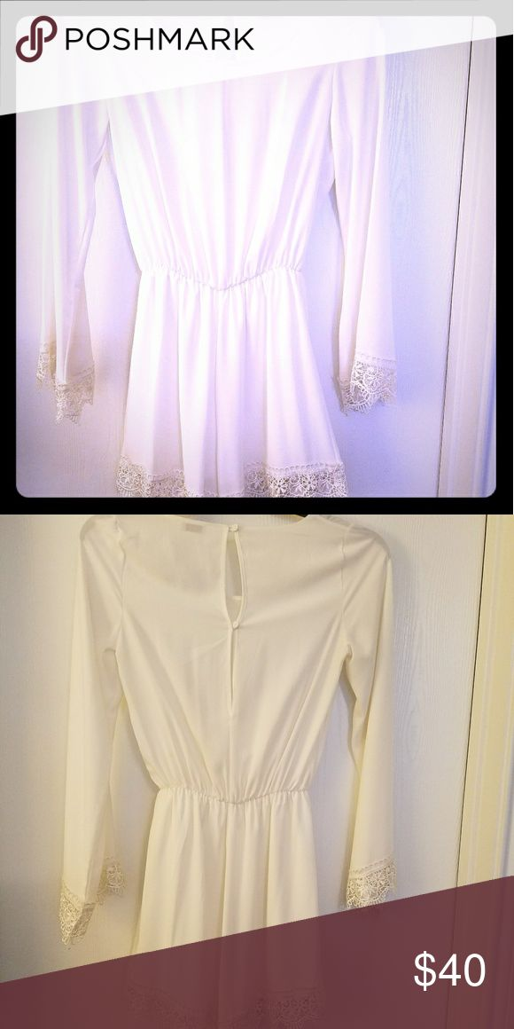 Cream Playsuit / lace detail EUC. Cream playsuit with lace detail on sleeves and shirts. Shorts are lined. Can dress up or down for a casual or dressy look. Romper was worn once. Tobi Shorts