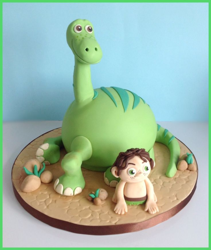 "Good Dinosaur Cake: The finished cake, featuring edible versions of Arlo and Spot from Pixar's ""The Good Dinosaur"""