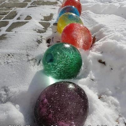 Fill balloons with water and add food coloring, once frozen cut the balloons off & they look like giant marbles or Christmas lights. If you live someplace cold enough to keep them frozen I think this would be great for outdoor Christmas decor.