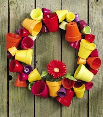Decorate your outdoor space with a flower pot wreath.  This would be cute by your potting table.  :-)