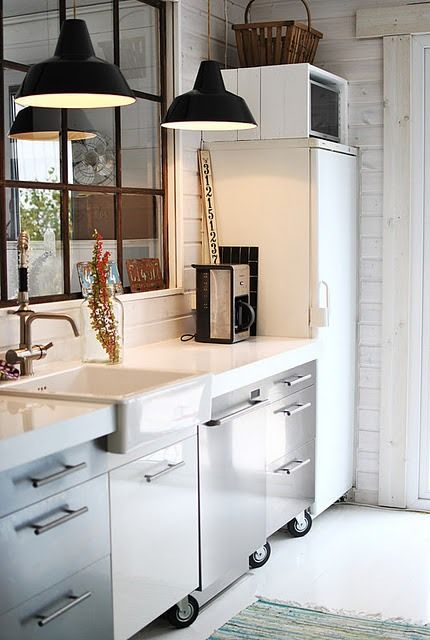 Kitchen. Industrial features contrasted against traditional sink, single pane window...