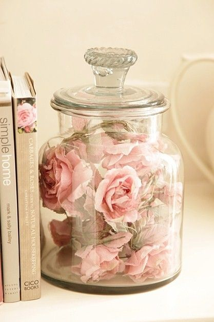 Artificial flowers in glass canisters.