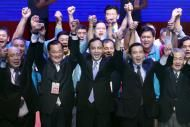 Flanked by Nationalist party heavyweights, honorary chairman Lien Chan, second from left, and current President Ma Ying-jeou, second from right, Taiwan's ruling Nationalist Party chairman and presidential candidate in the 2016 elections Eric Chu, center, raise their arms in celebration during an extraordinary party congress in Taipei, Taiwan, Saturday, Oct. 17, 2015. Taiwan's ruling party dumped its unpopular presidential candidate Hung Hsiu-chu for party Chairman Chu to lead the ticket on…
