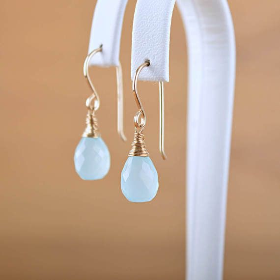Simple wire wrapped Aqua Blue Chalcedony Earrings are great for your beach wedding, as a gift for your bridesmaids or yourself. Wrapped with 14k Gold Filled wire and dangling from fully handmade French type earwires. AQUA BLUE CHALCEDONY EARRINGS, DANGLE DROP ✓ Made with top