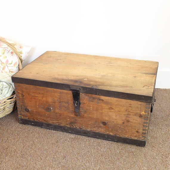 Late 19th or early 20th Century wooden munitions box with metal banding, perfect for use as a blanket box, or low coffee table. Brilliant extra bedroom storage especially useful at Christmas!  This wooden chest measures 67 cm wide by 40 cm deep and is 28 cm tall. Original metal banding and handles.    For more vintage treasures, homewares and gifts, please visit my website: https://www.tiddlerandfox.com