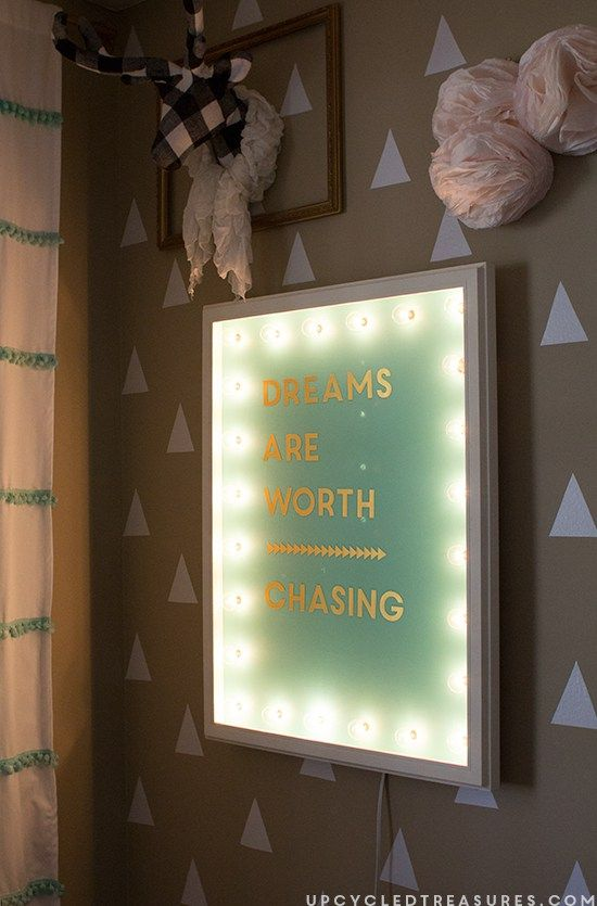 Want to make your very own lit up sign? Check out how to make an upcycled DIY Marquee Sign from a thrifted frame. MountainModernLife.com