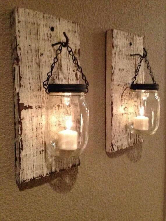 Wall sconces made out of rustic wood, hooks and mason jars. Would look awesome lining a staircase.