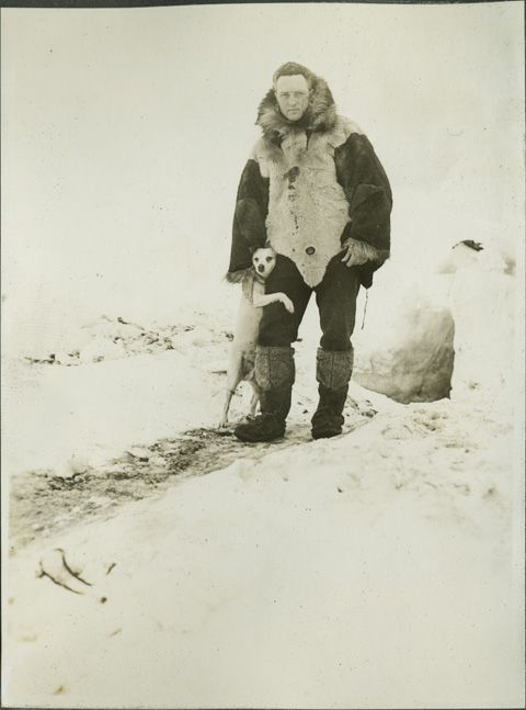 "Admiral Richard E. Byrd, with his pet dog ""Igloo,"" ca. 1928. Igloo was quite the world traveler, and accompanied Byrd on polar expeditions to both the Arctic and the Antarctic."