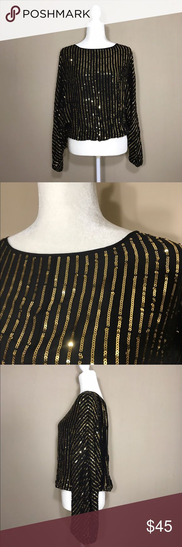 Rachel Zoe Sequin Black and Gold Slouchy Top Gorgeous sequin top by Rachel Zoe.  In mint condition, size M.  100% silk. No trades please. Thank you for stopping by  Rachel Zoe Tops Blouses
