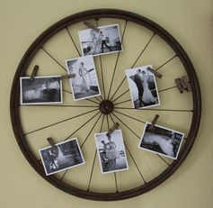 Old bike wheel turned photo display!