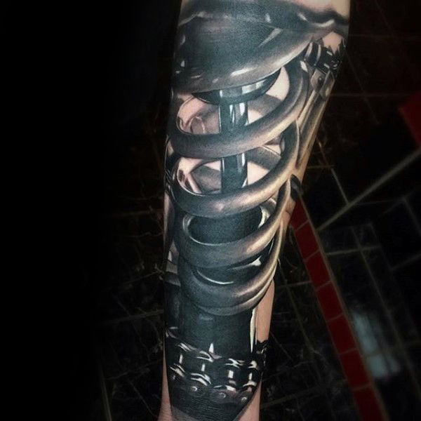 Man With 3d Realistic Motocross Shock Tattoo On Forearm