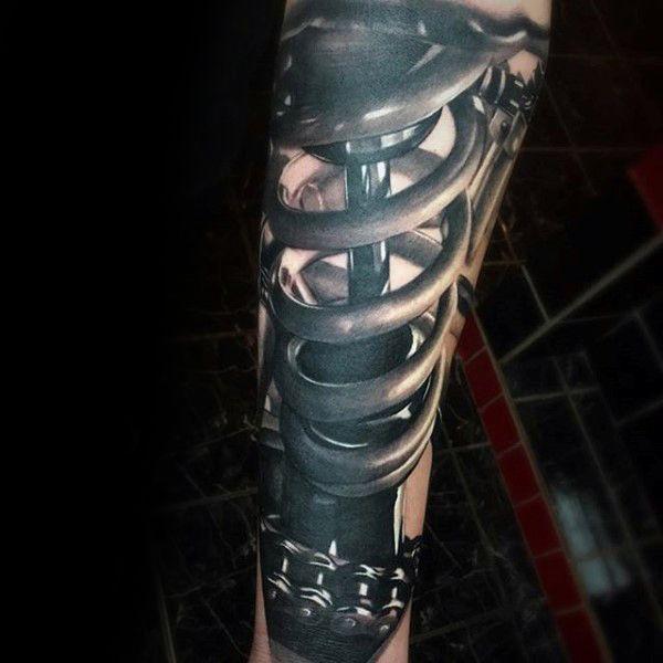 Mann mit 3d Realistische Motocross Shock Tattoo auf Unterarm-