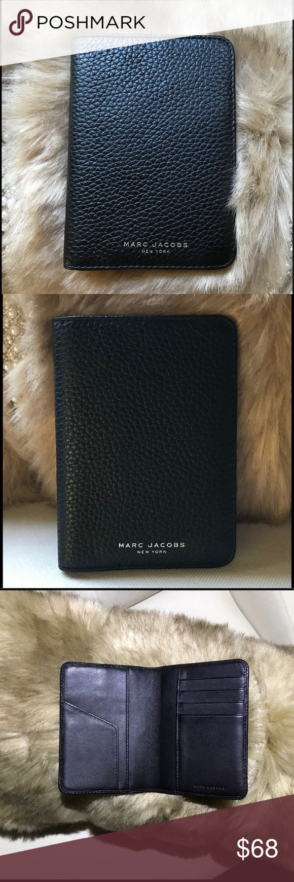 Marc Jacobs Gotham city pebble leather passport Beautiful pebble black leather unisex passport. Gold Marc Jacobs logo on front and Marc Jacobs embossed inside. 4 slots for credit cards and soft smooth leather. Perfect condition never used. Great Christmas gift 🎁 Marc Jacobs Bags Wallets