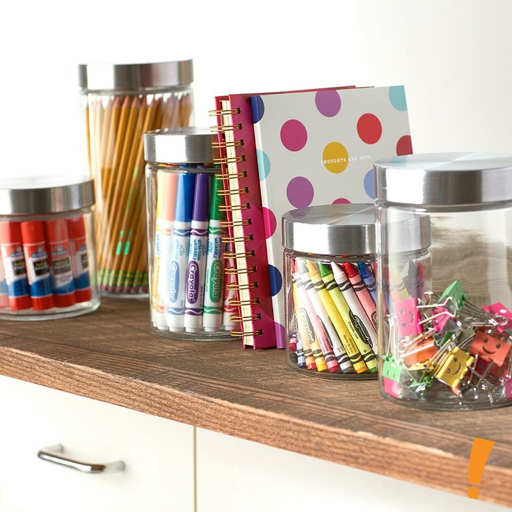 Looking to organize your kids' homework space? Try sorting their supplies into clear glass jars!