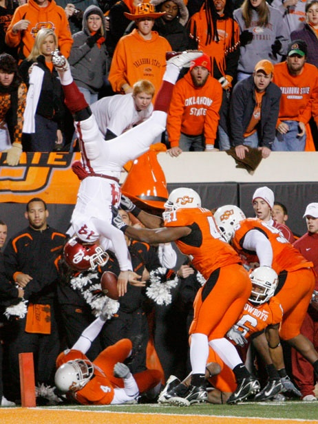 OSU > OU .....idk why sooners think this is a good picture for their team....obviously the guy is being flipped upside down by the cowboys...and I recall this wasn't even a touchdown... TRUST ME I WAS THERE!!! BCS CHAMPS 2011