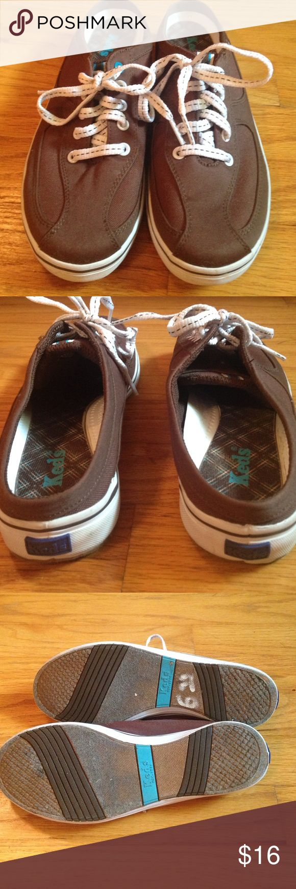 Keds sz 7 slip on brown sneakers Keds sz 7 slip on brown sneakers. Teal and white accents. Brown and white laces. Very comfortable cushiony inner sole. Worn a couple of times. Only wear is shown on bottoms (see pic). The rest are in perfect, almost- new shape! Keds Shoes Sneakers