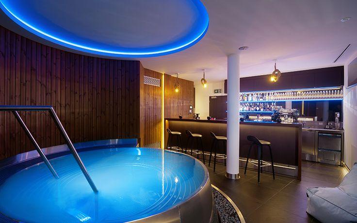 Stainless steel whirlpool Imaginox next to bar in hotel wellness