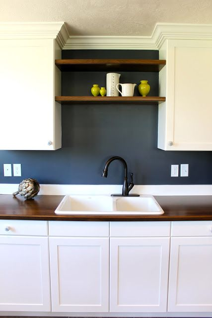 hale-navy-kitchenette-transformation...love the white rustic wood accents and navy walls