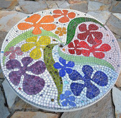 http://www.swanmosaic.com. Mosaic patio table top.    We can get all fancy about it. lol!