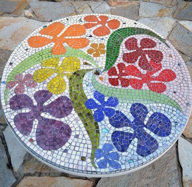 http://www.swanmosaic.com. Mosaic patio table top.