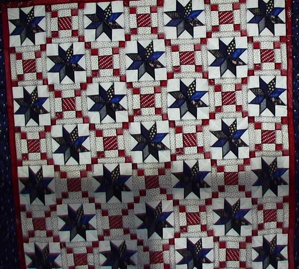 """8 pointed stars are different navy fabrics and red and white blocks are courthouse steps. It is a 80x80"""" window covering."""""""